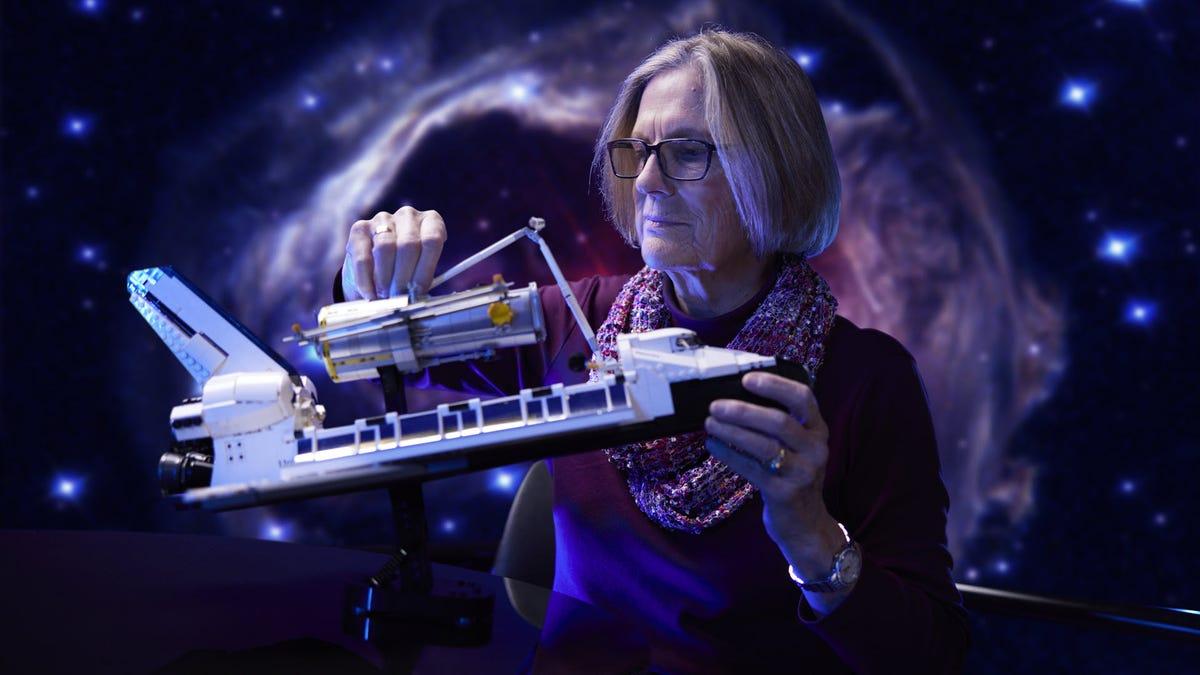 NASA Astronaut Kathy Sullivan holding a LEGO Space Ship Discovery