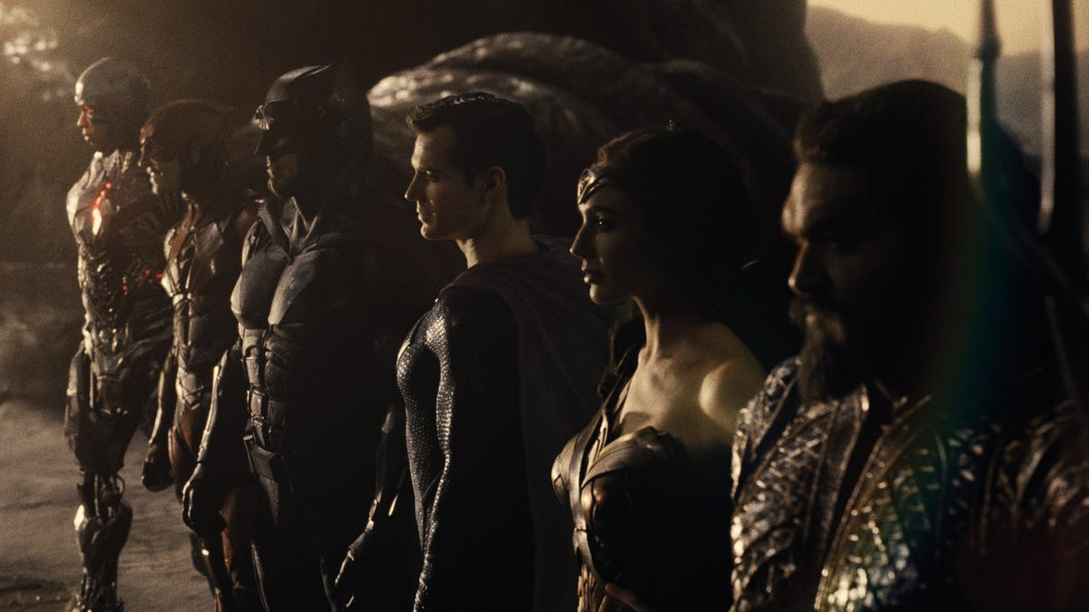The entire Justice League lineup in a dark setting
