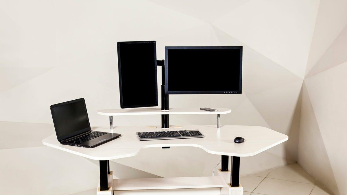 Multiple monitor setup on white angular desk