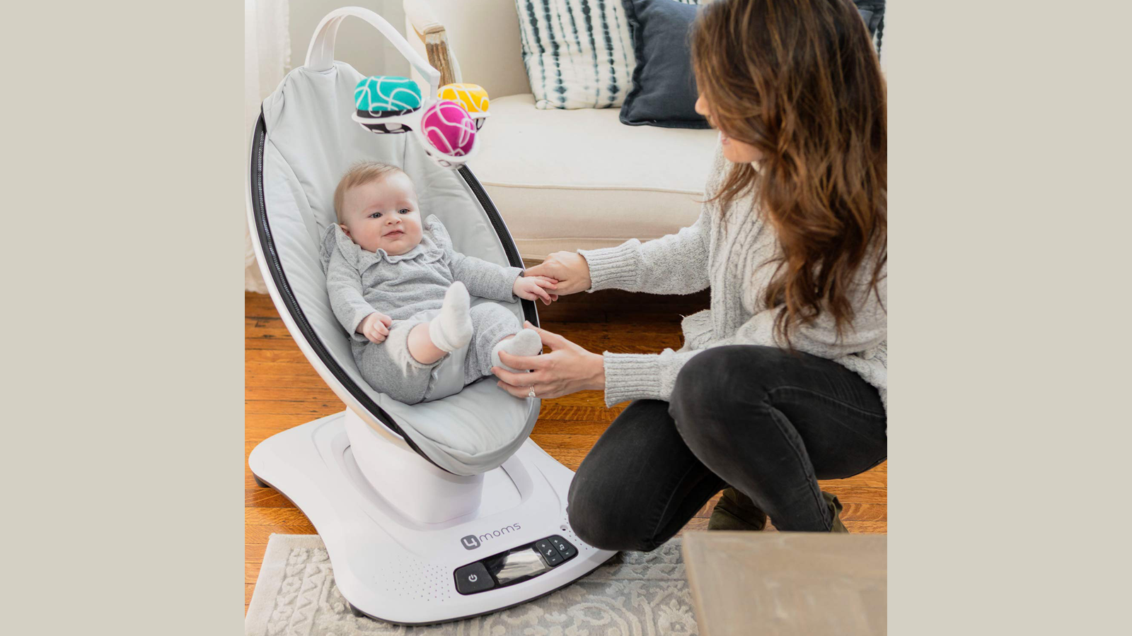 mamaRoo Smart Baby Swing from 4moms with baby and watchful mom in the living room