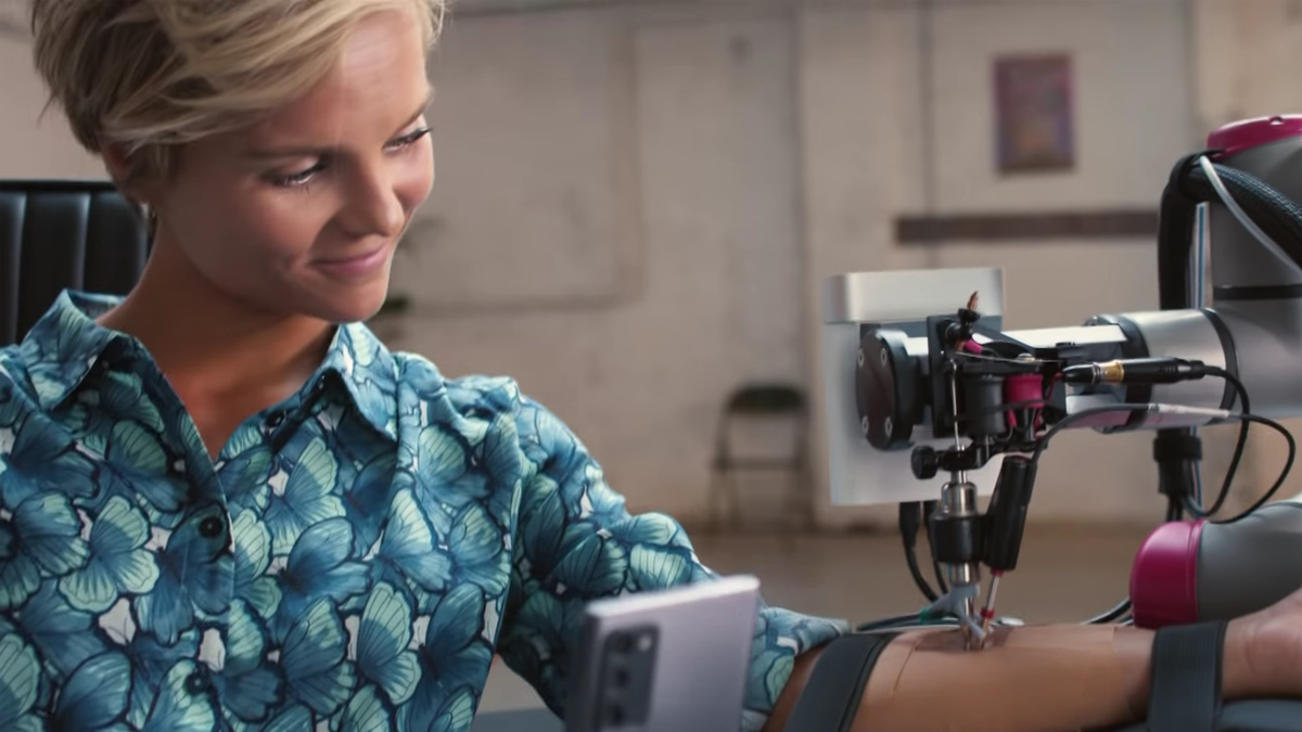 Netherlands actress getting real-time remote tattoo from artist in London