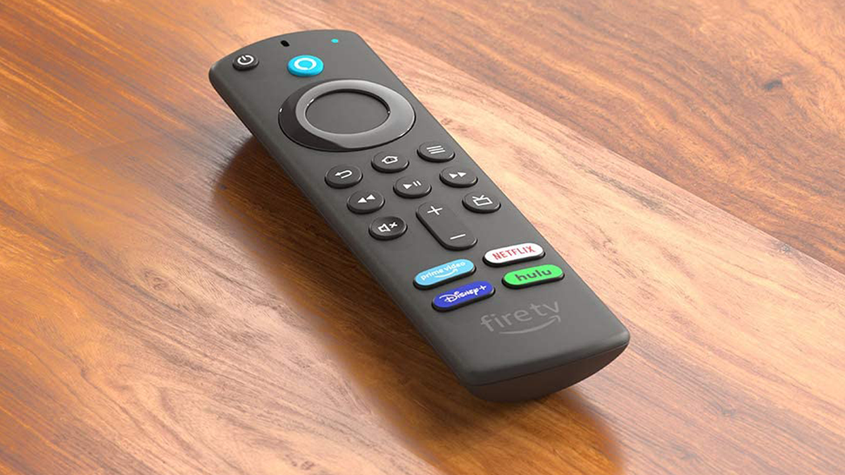 Amazon third-gen Fire TV remote control on wooden surface