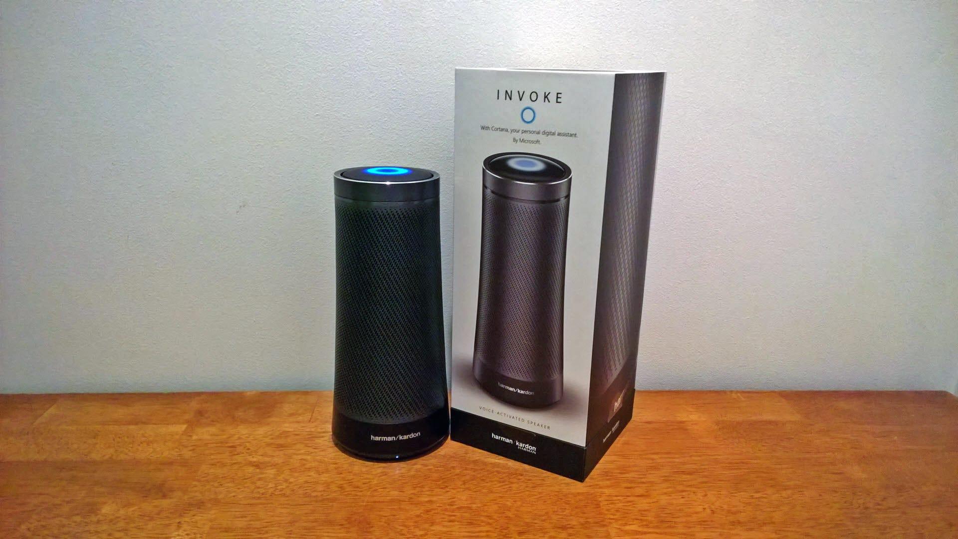 A Harmon-Kardon Invoke speaker next to its box.