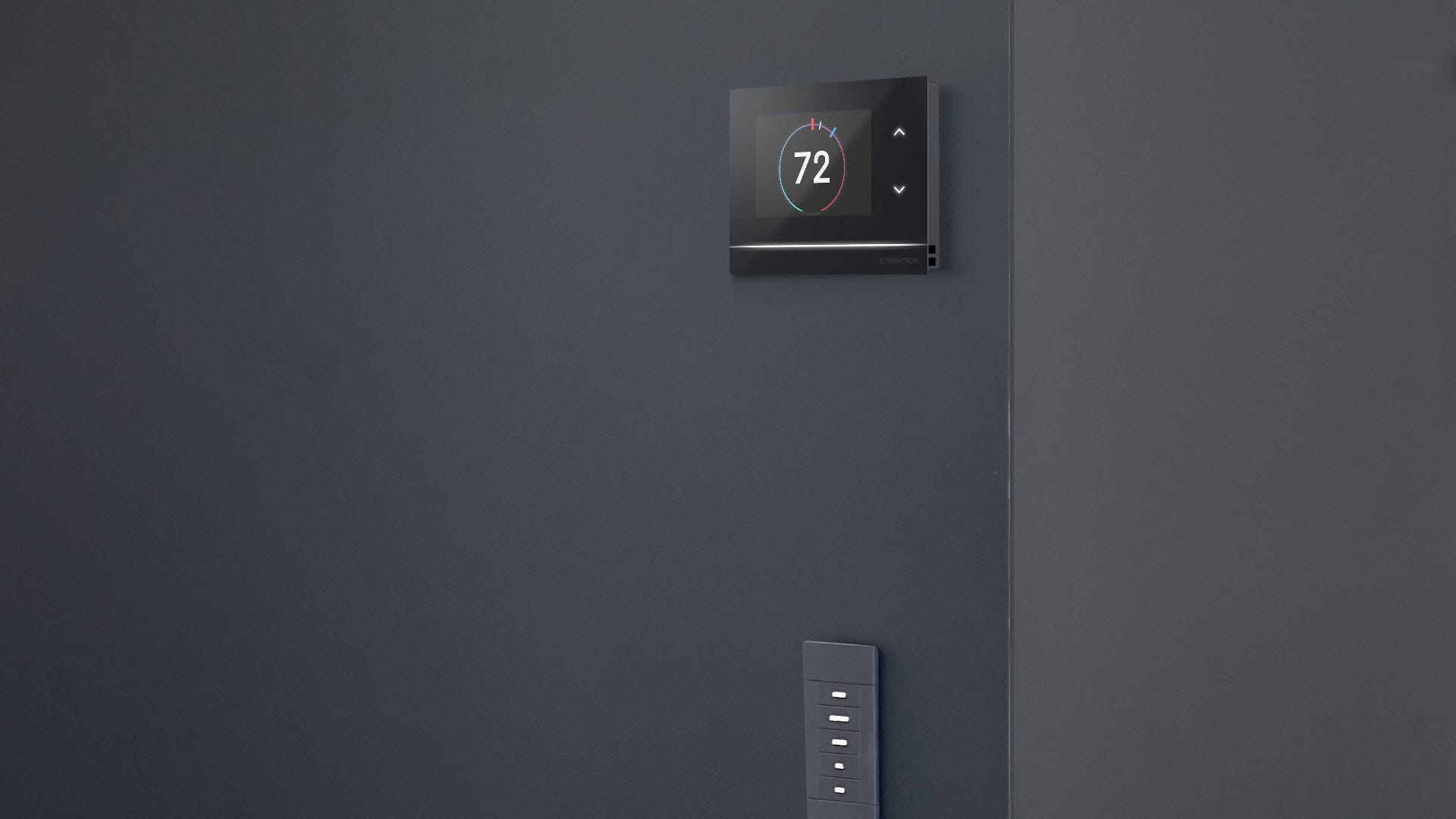 A Crestron Thermostat above a light switch