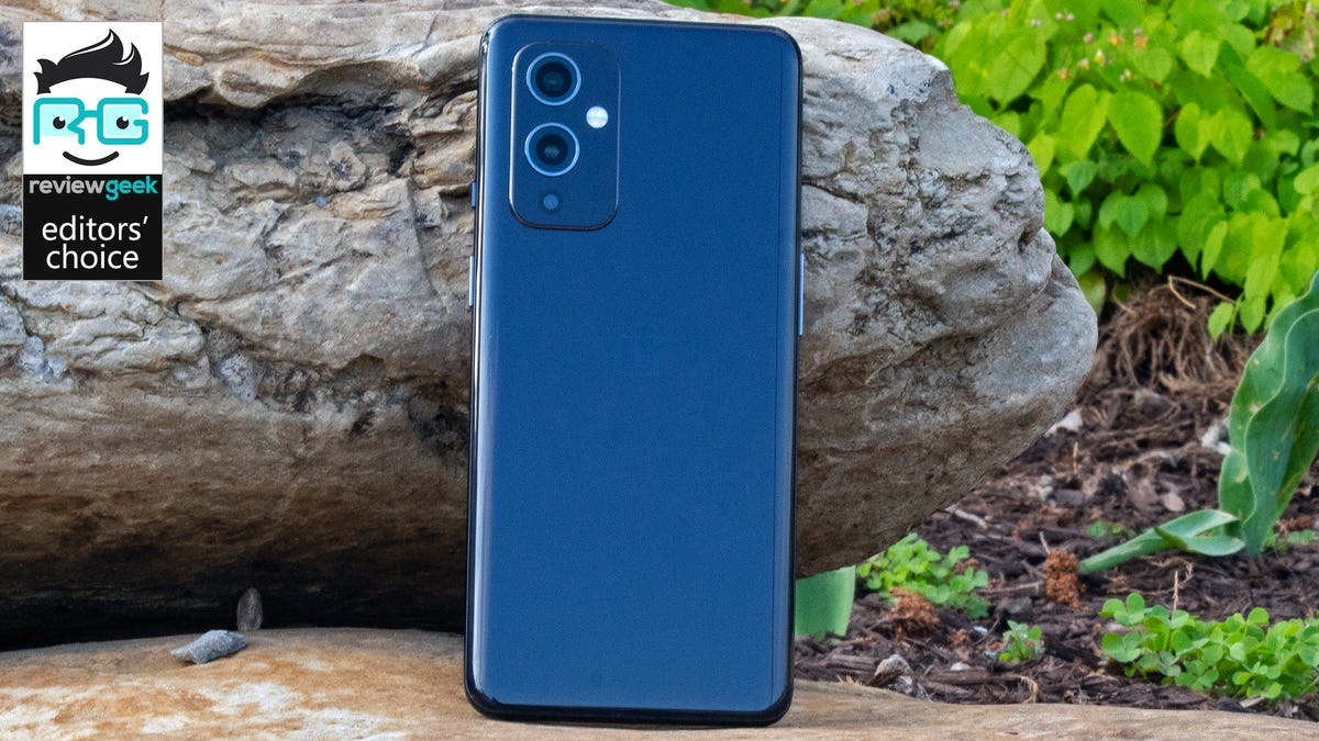A closeup of the OnePlus 9 against a rock.