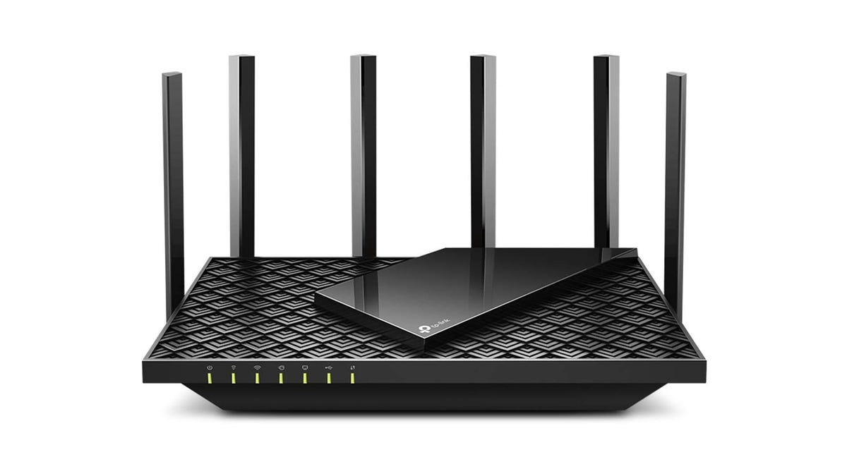 A TP-Link Archer AX5400 router with six antennas