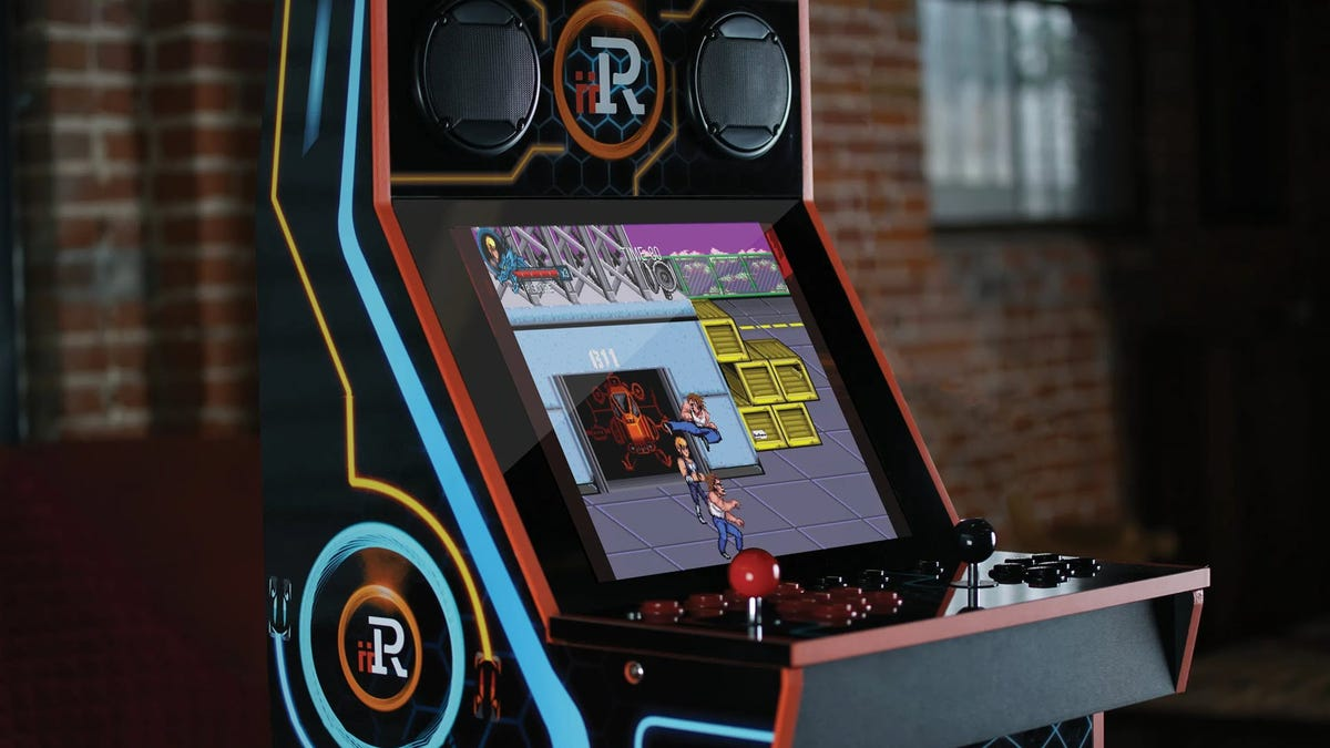 "An arcade cabinet with ""Double Dragon"" on the screen"