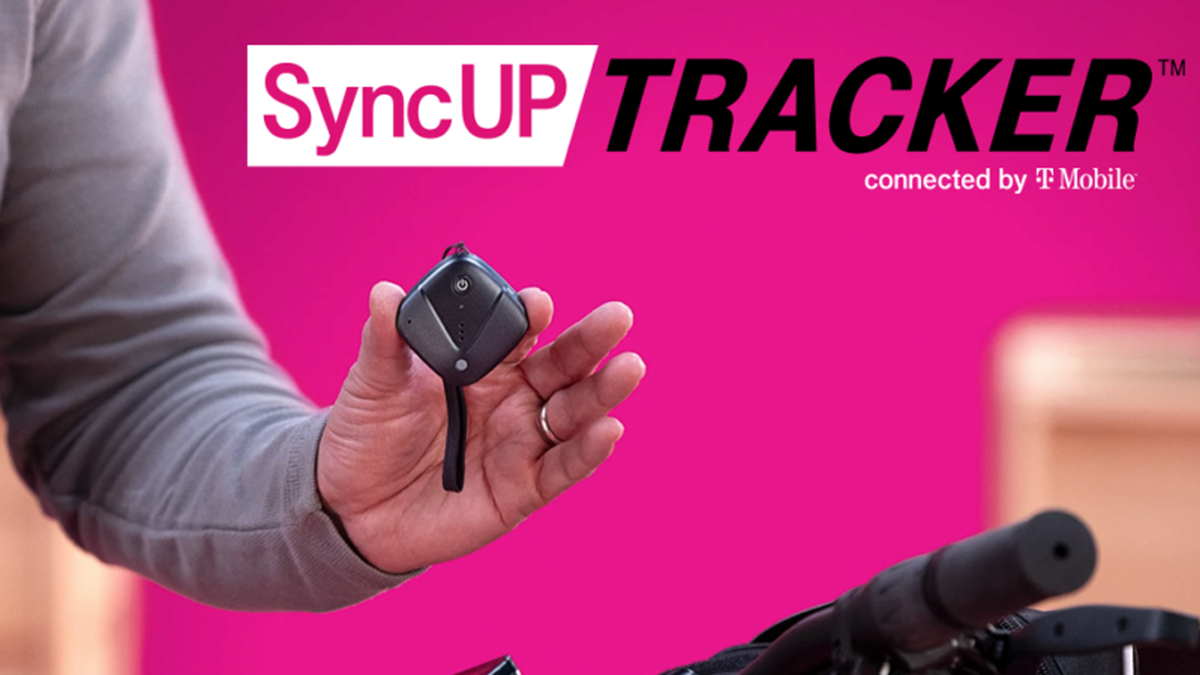 T-Mobile's New SyncUP TRACKER being held up over a bike against pink background