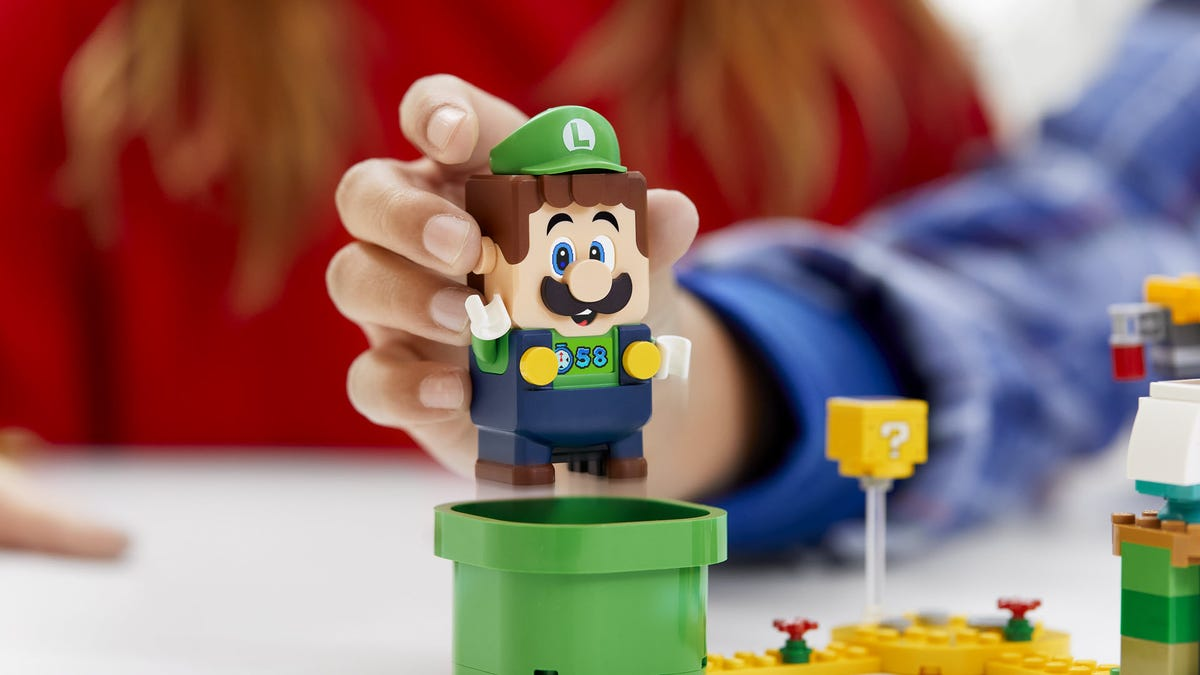 A LEGO Luigi figure coming out of a warp tube.