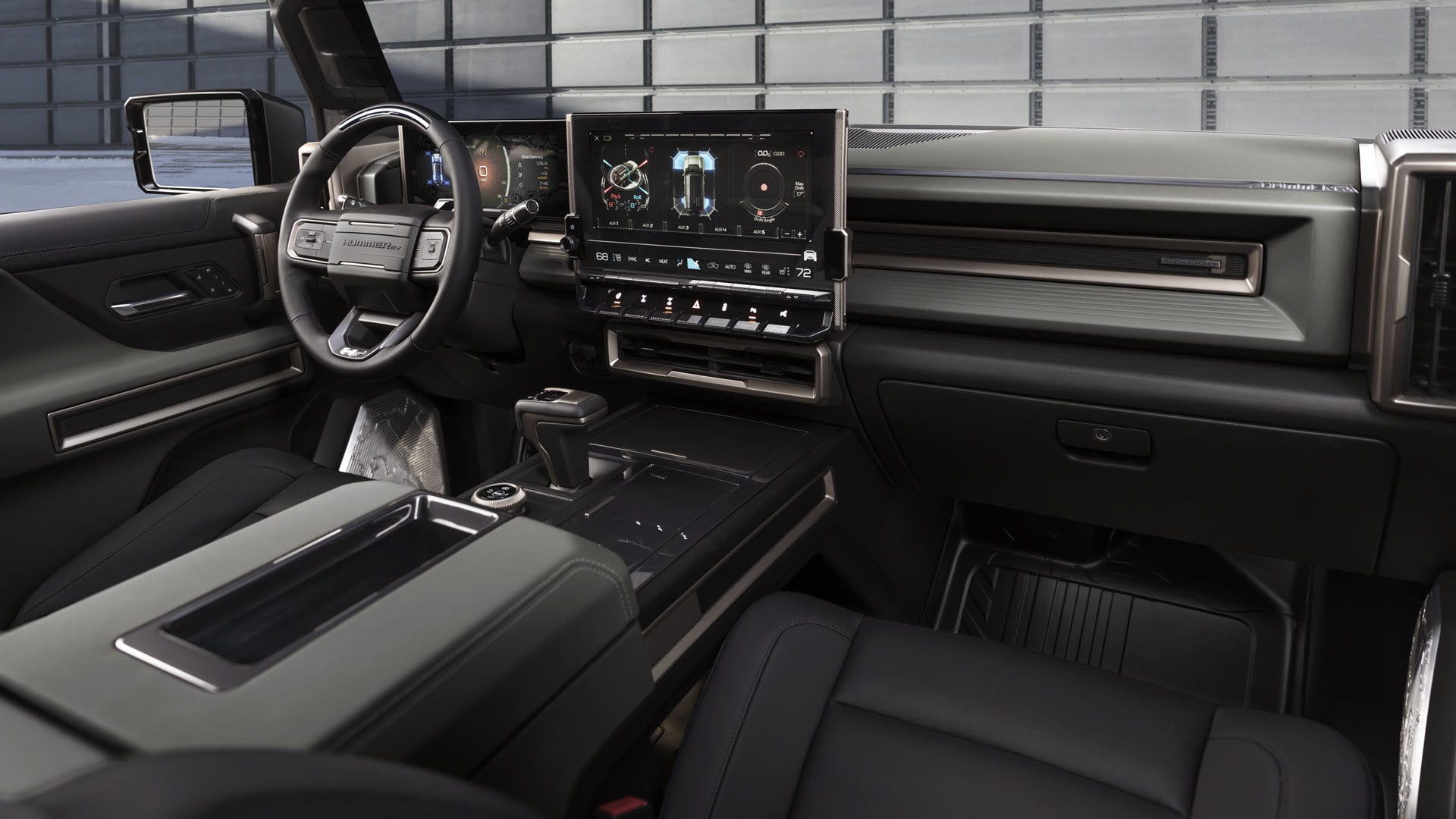 A interior of a Hummer EV with a large touchscreen dashboard.