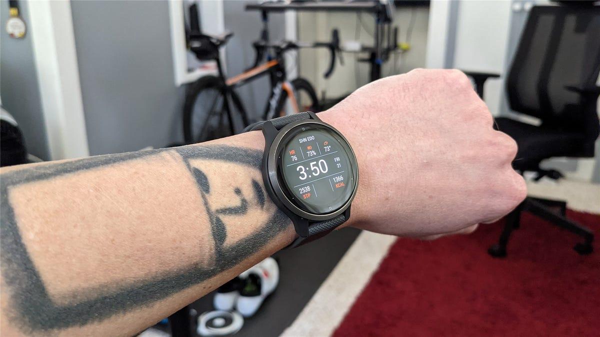 Wearing a Garmin Watch, a bike in the background