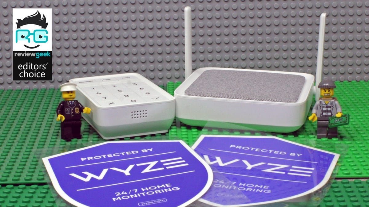 A Wyze Home Monitoring hub and keypad, along with security stickers.