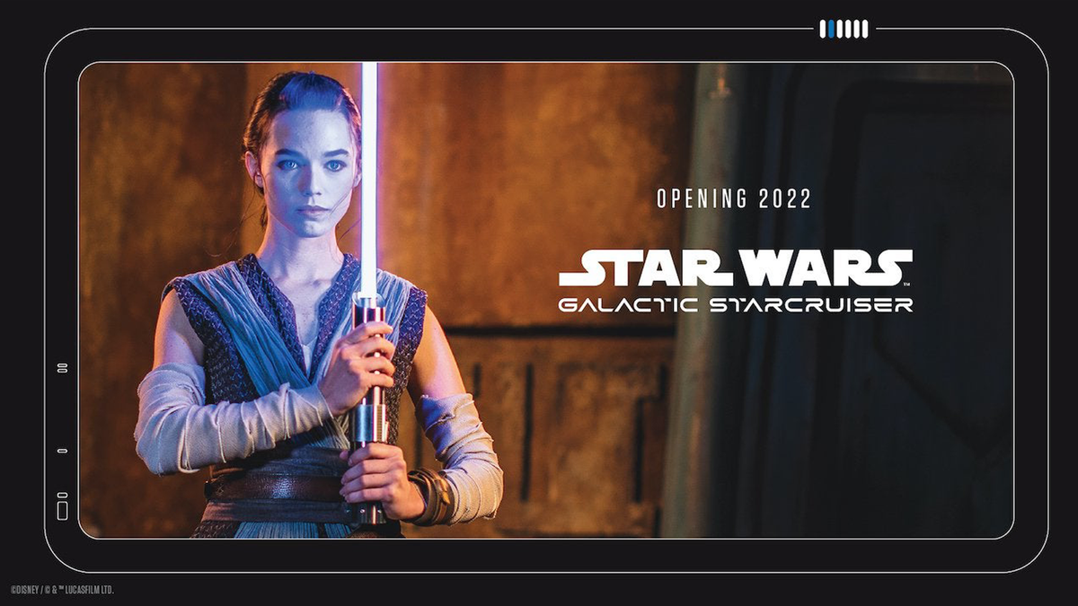 "Disney's new ""real"" lightsaber held by person cosplaying as Rey"