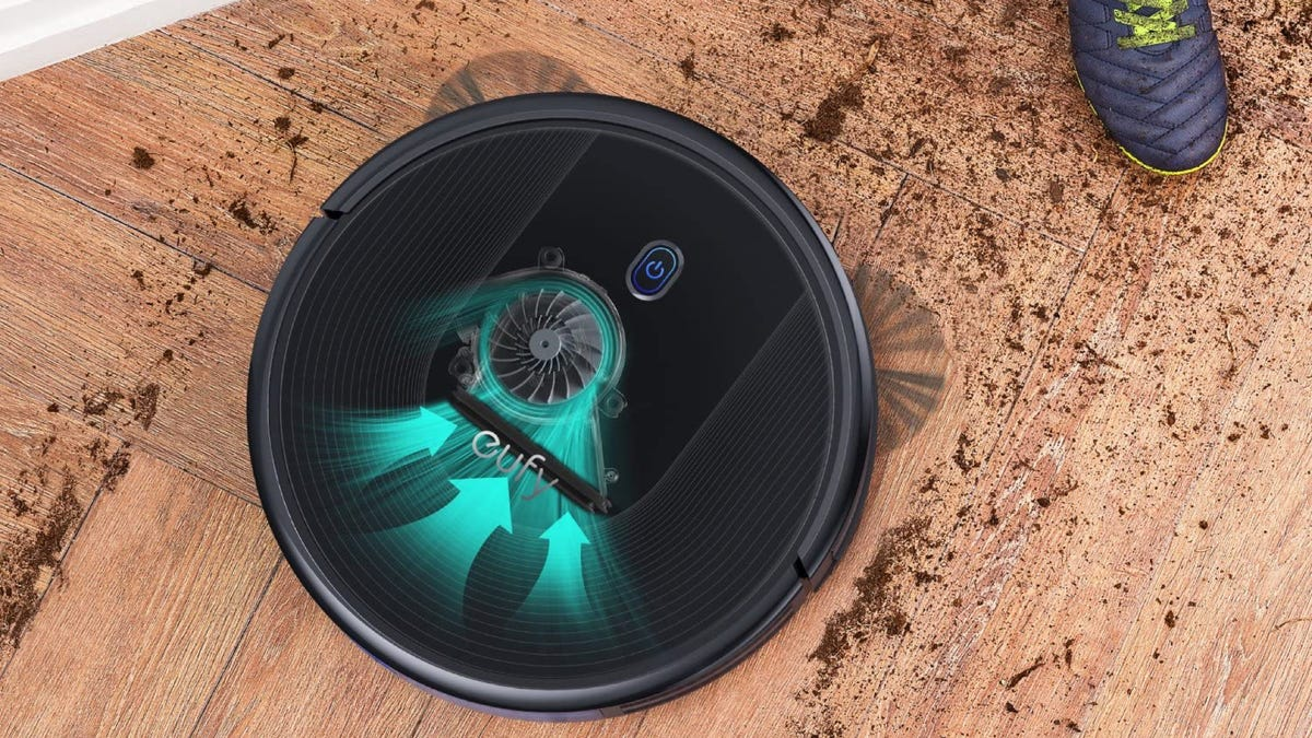 Eufy Robot Vacuum cleaning a dirty floor