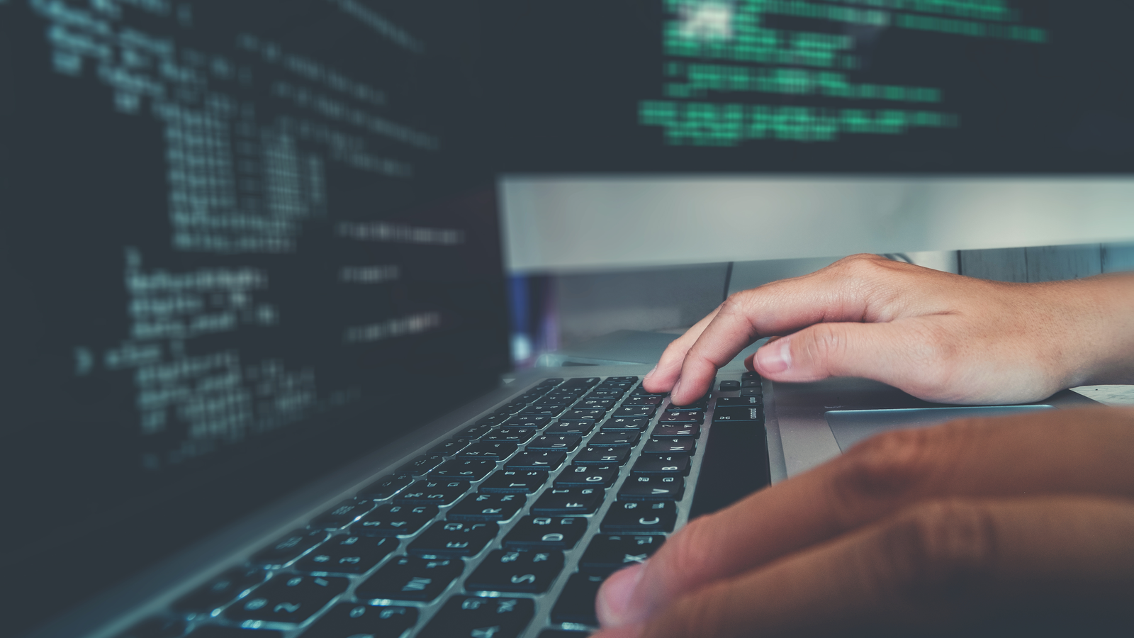 Developer programmer typing code for a website in an office