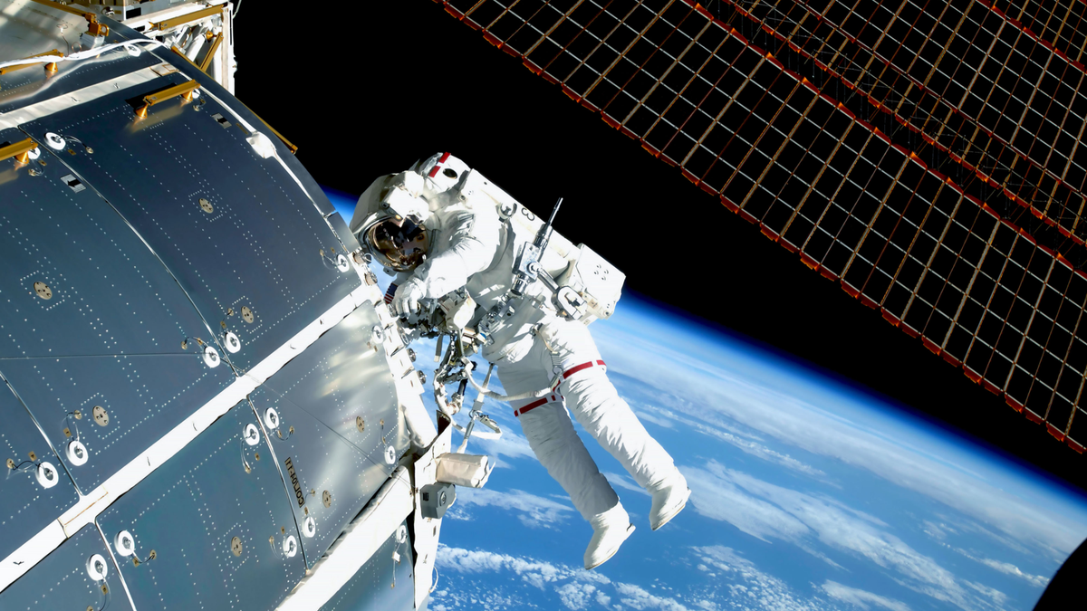 Astronaut at the International Space Station outside repairing the craft