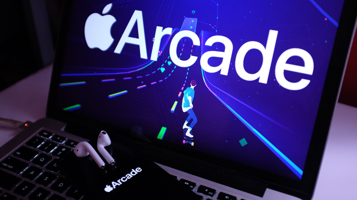 AirPods, MacBook Pro, iPhone 11 with Apple Arcade logo