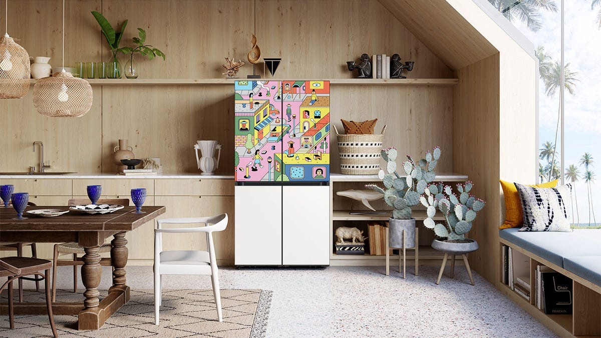 A refrigerator covered in pop artwork.