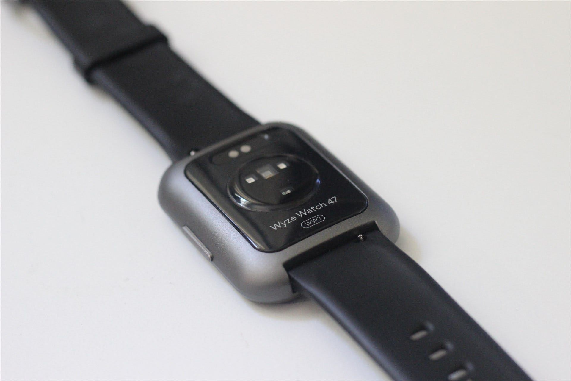 The back of the Wyze Watch 47, showing the heart rate sensors and charging port