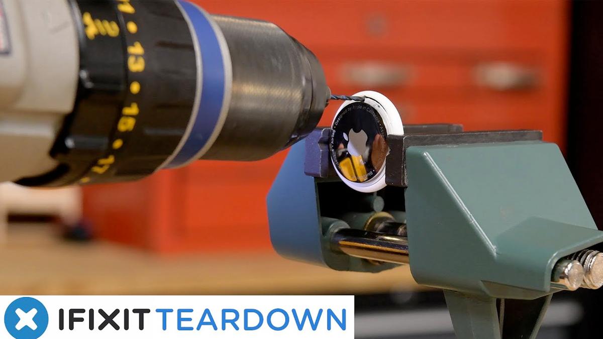 Drilling a hole through an AirTag.