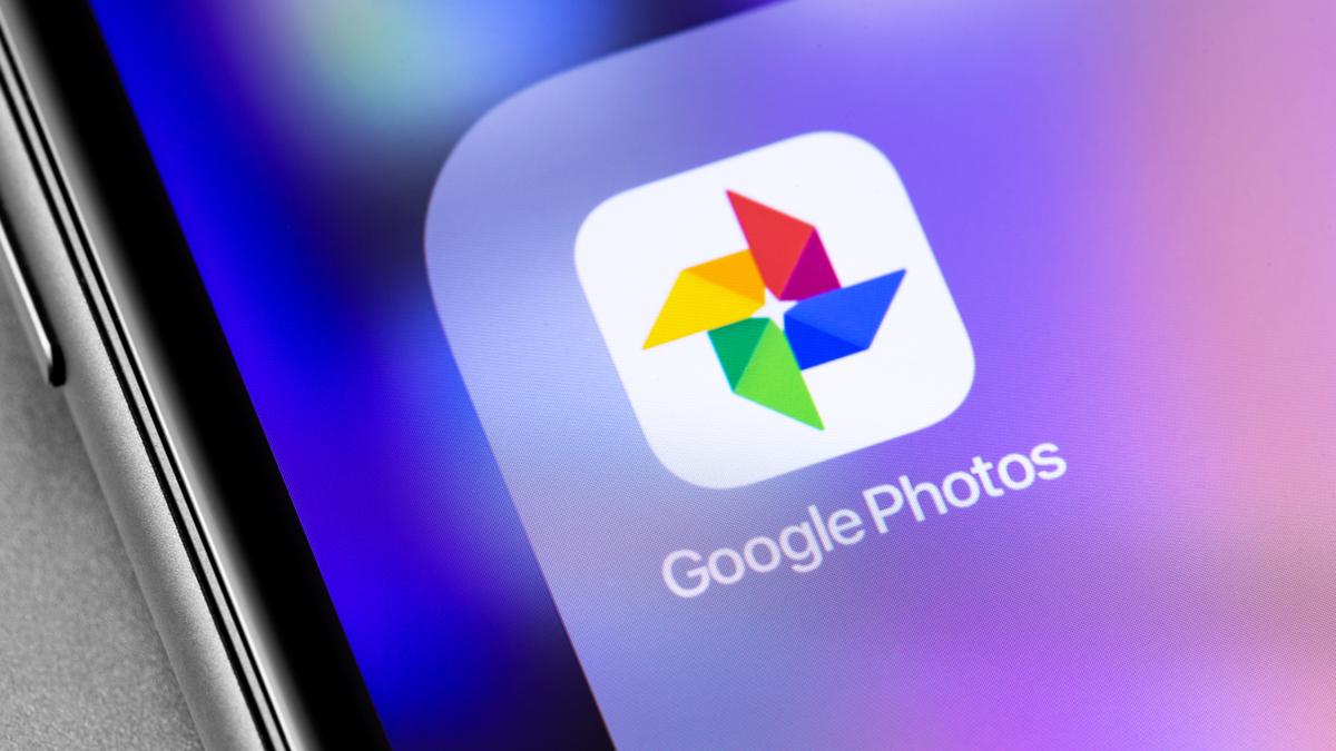 Google Photos application icon on smartphone screen closeup