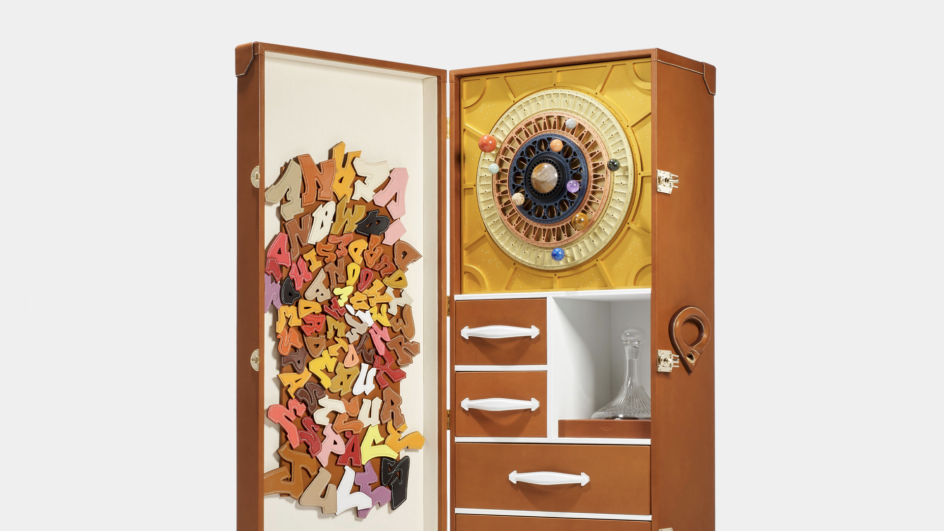 The Parisian Maison d'Arts Les Ateliers Victor suitcase is included with the space wine.