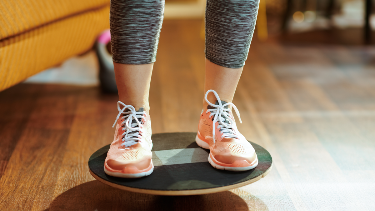 Person standing on a balance board.