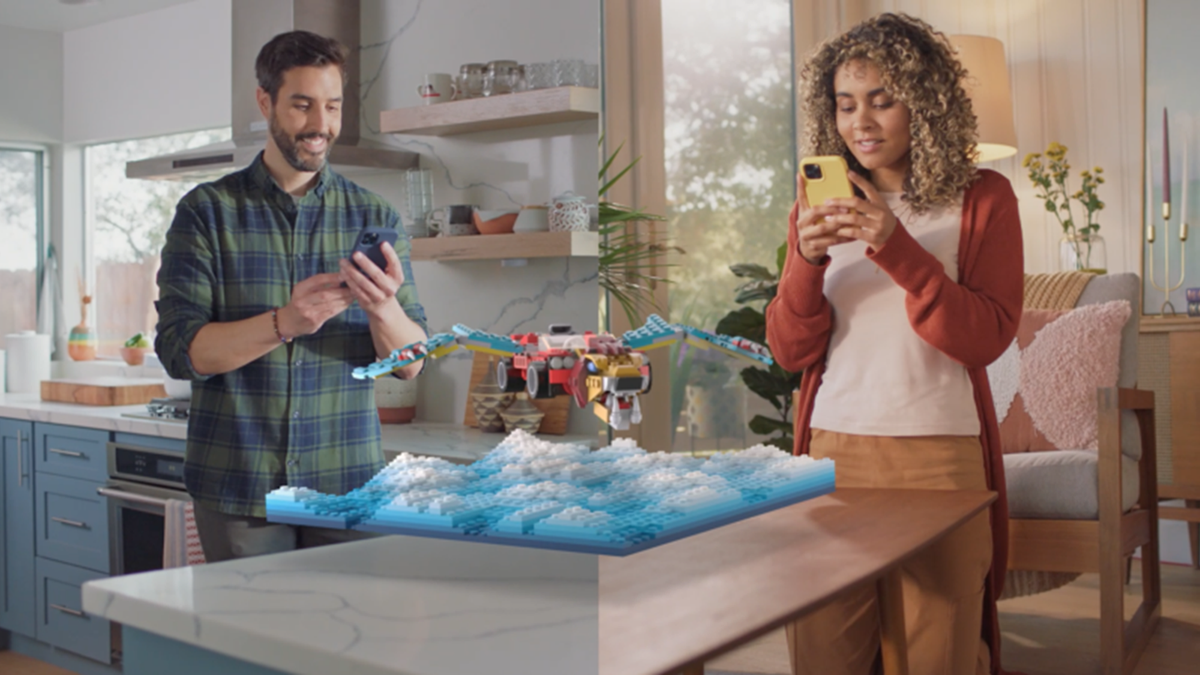 Two people building LEGO in augmented reality