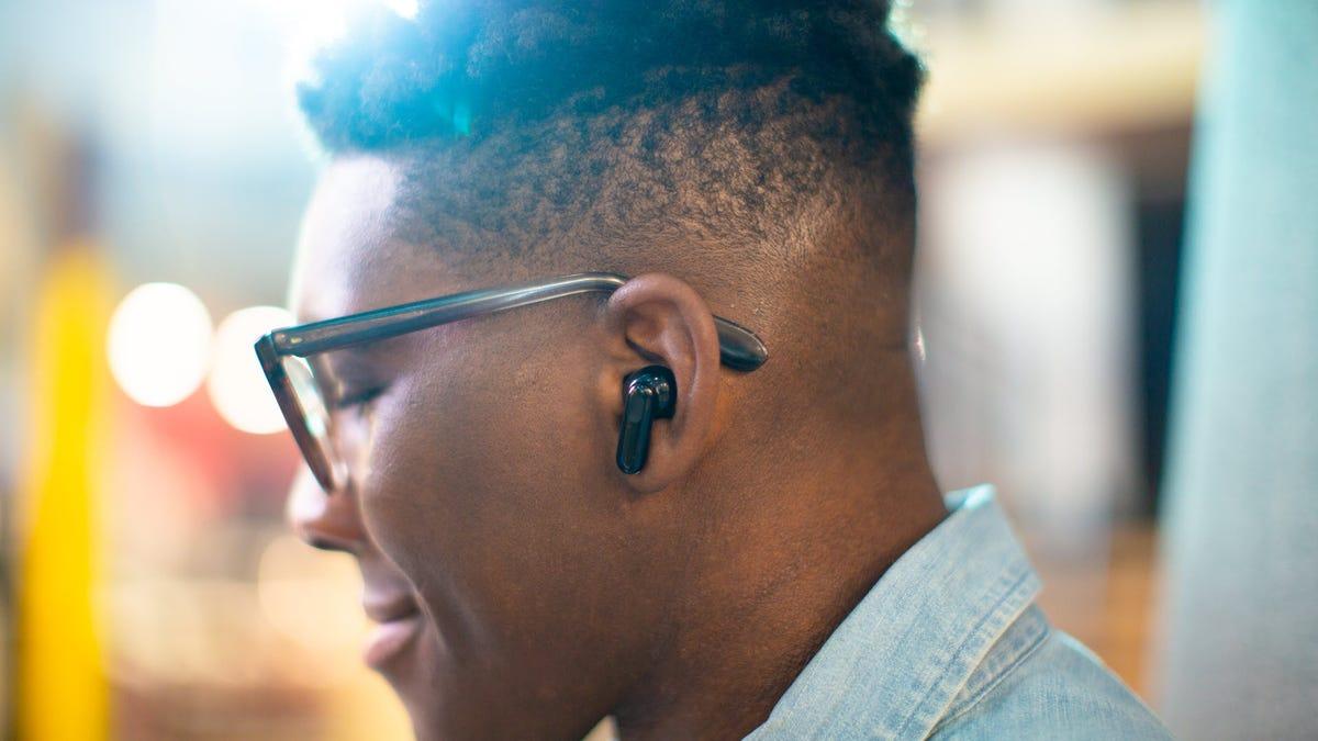 A pair of Wyze Bud Pro true wireless earbuds, in black.