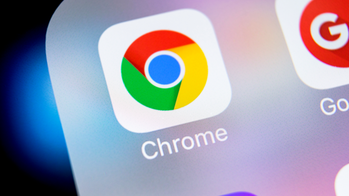 Google Chrome application icon on Apple iPhone X screen close-up