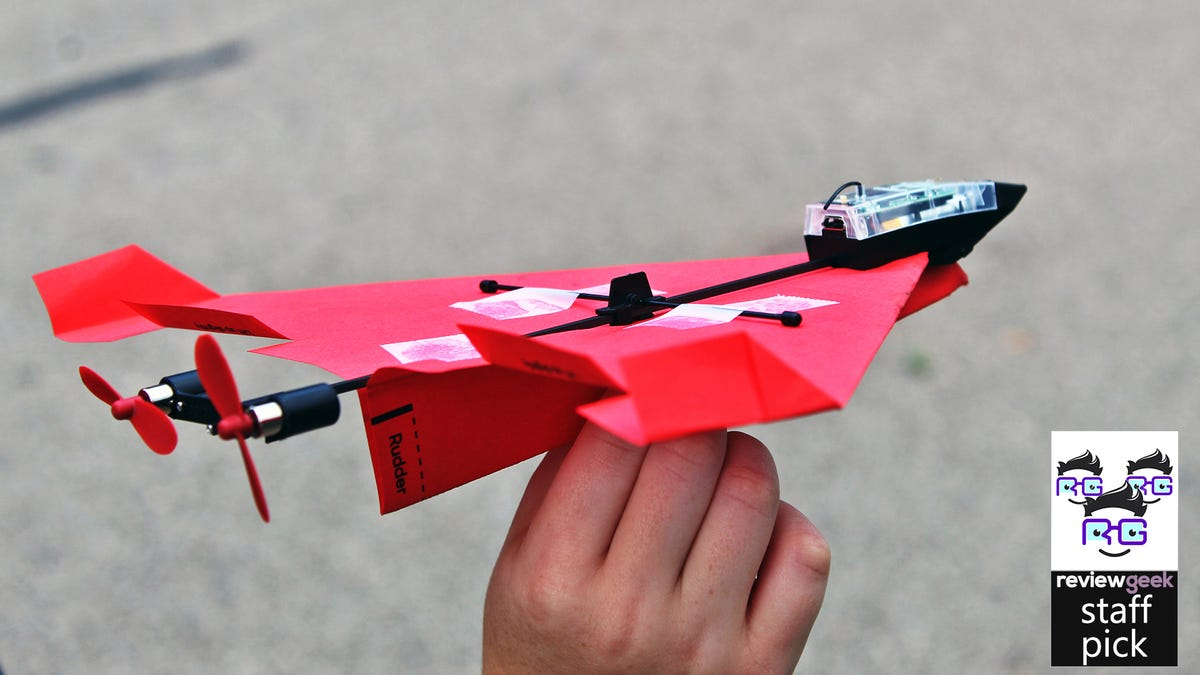 A paper airplane connected to an RC drone
