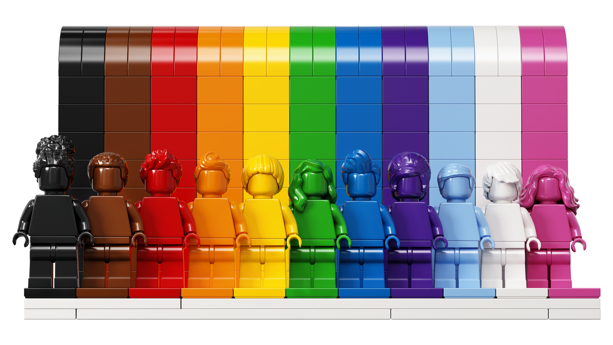 The Everything is Awesome LEGO set with 11 colors of the LGBTQIA+ flag and matching minifigures
