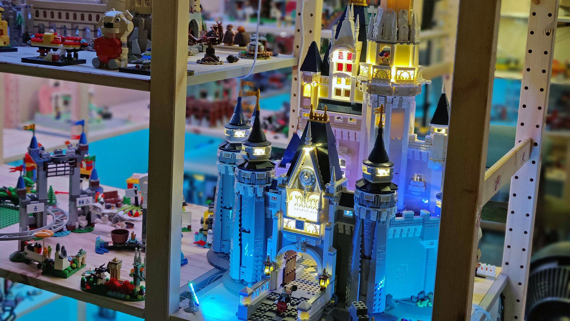 A LEGO Disney Castle with lit-sections.