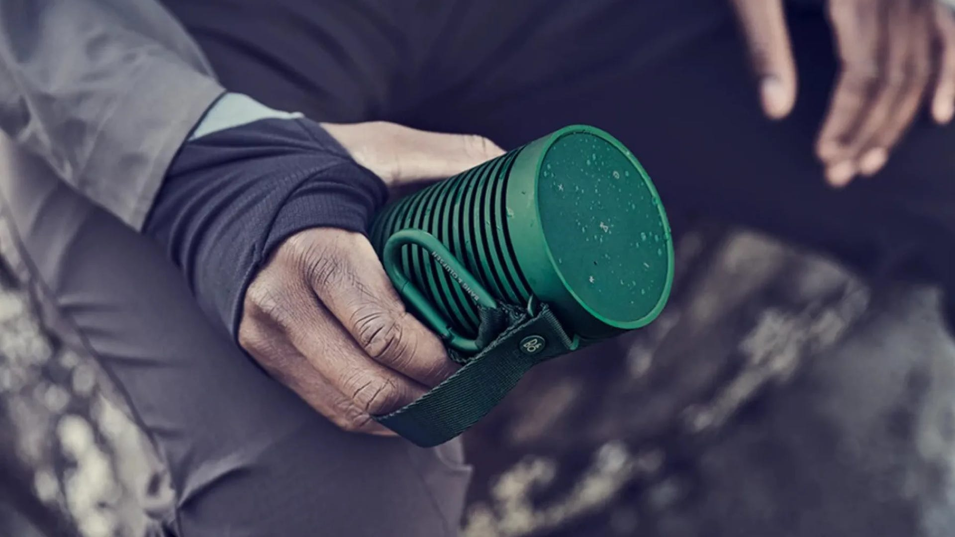 Bang & Olufsen green portable metal speaker