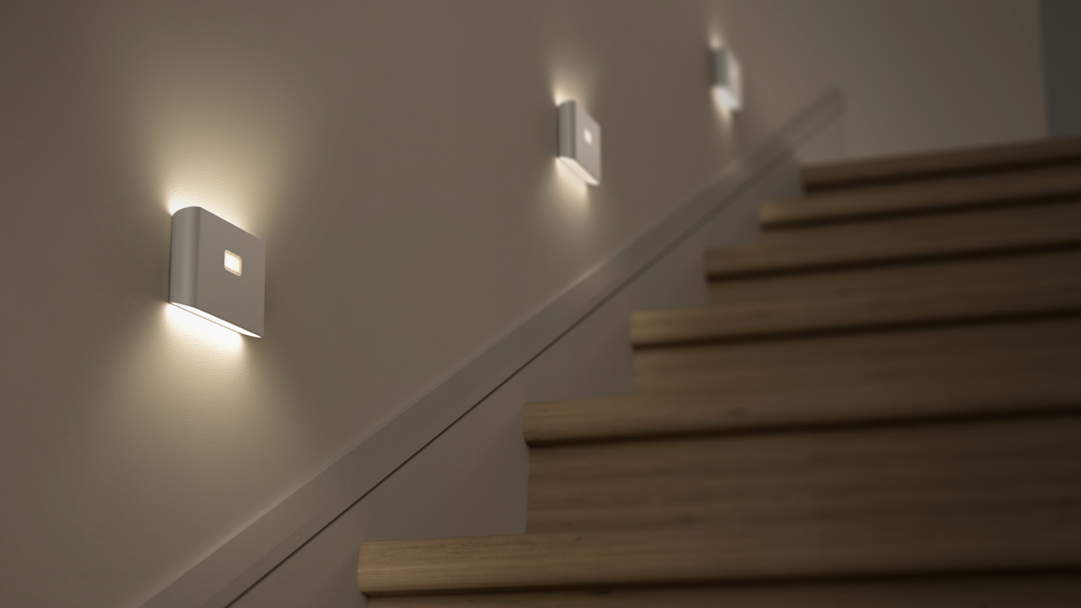 A set of night lights leading down some stairs.