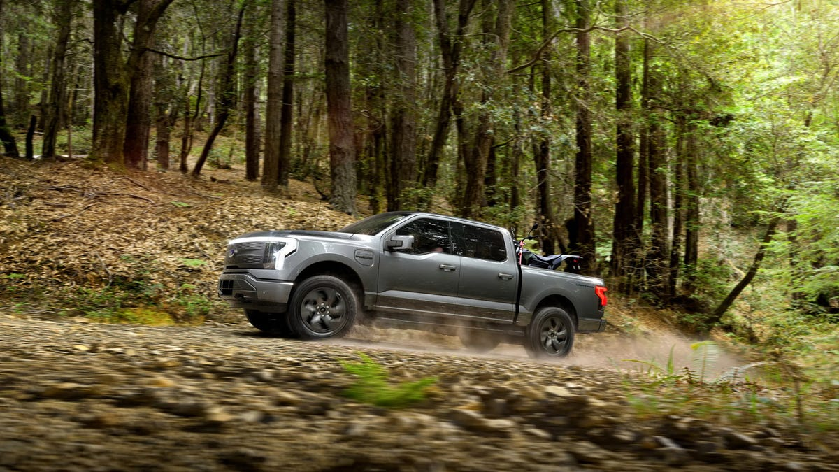 Ford F-150 Lightning driving outdoors