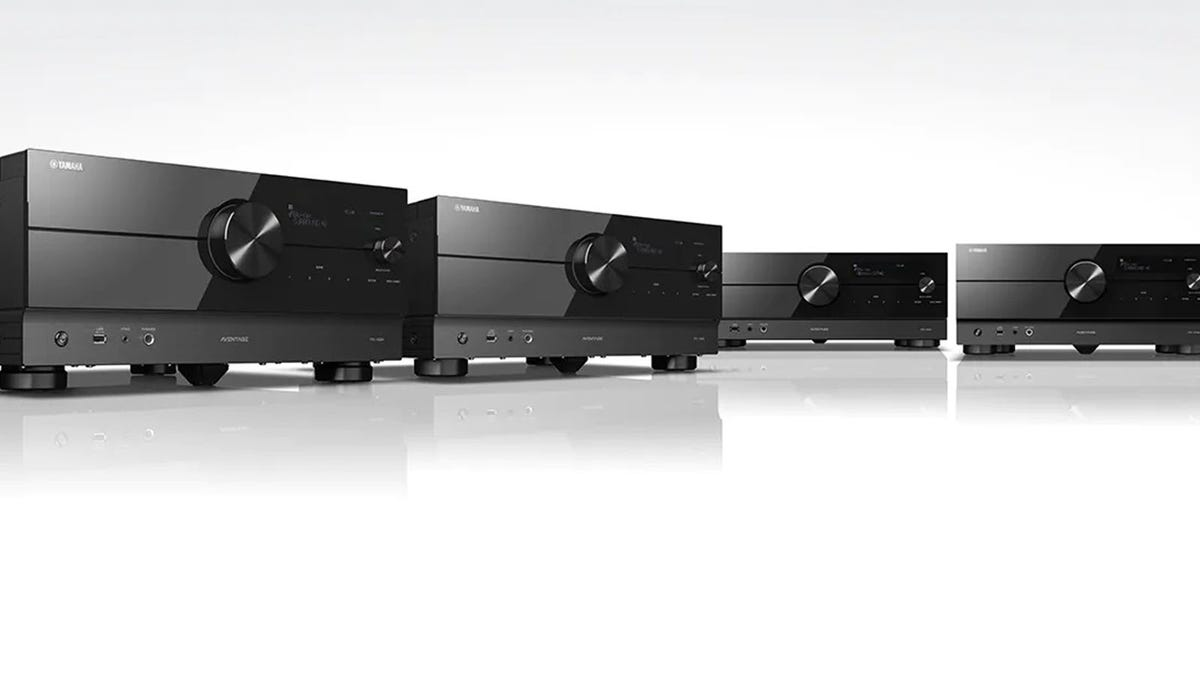 A series of Yamaha stereo receivers on a white background.