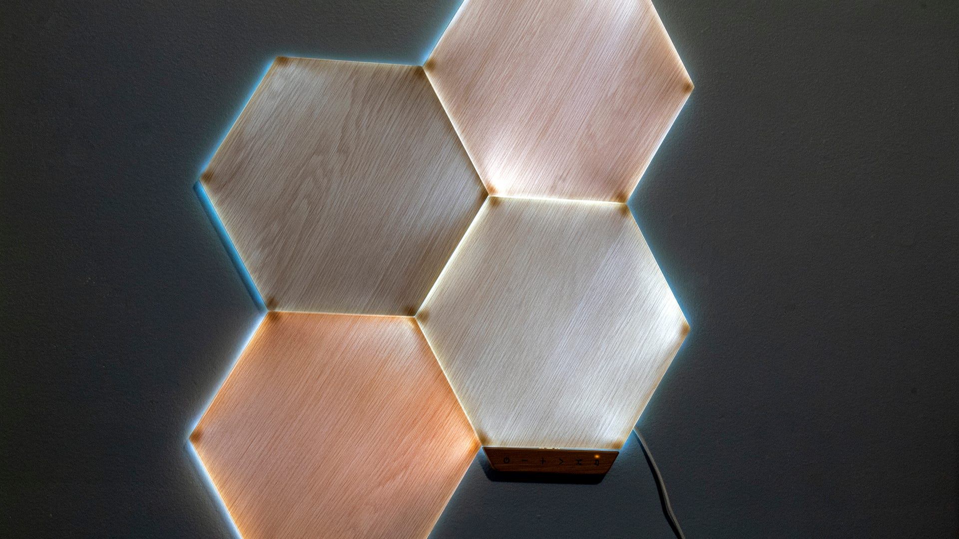 A closeup of lit woodgrain hexagon panels.