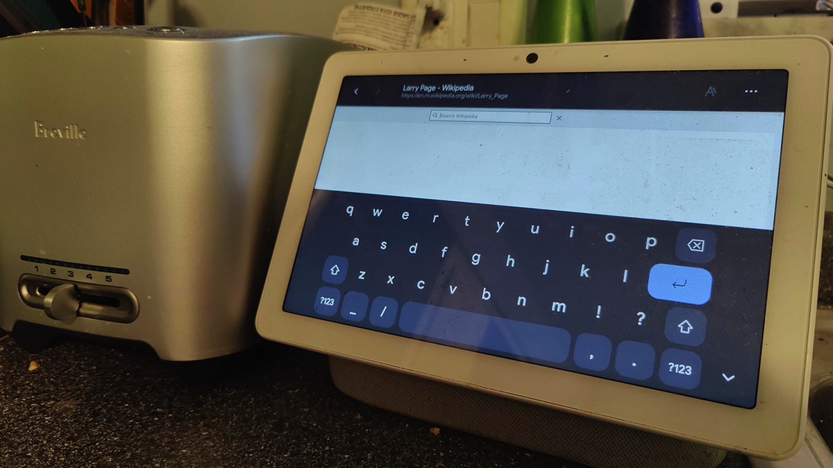 A Nest Hub with the virtual keyboard in browser.