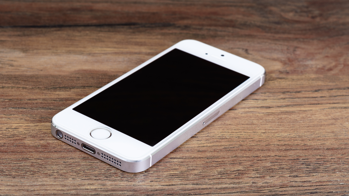 Apple iPhone 5 in white on a wooden surface
