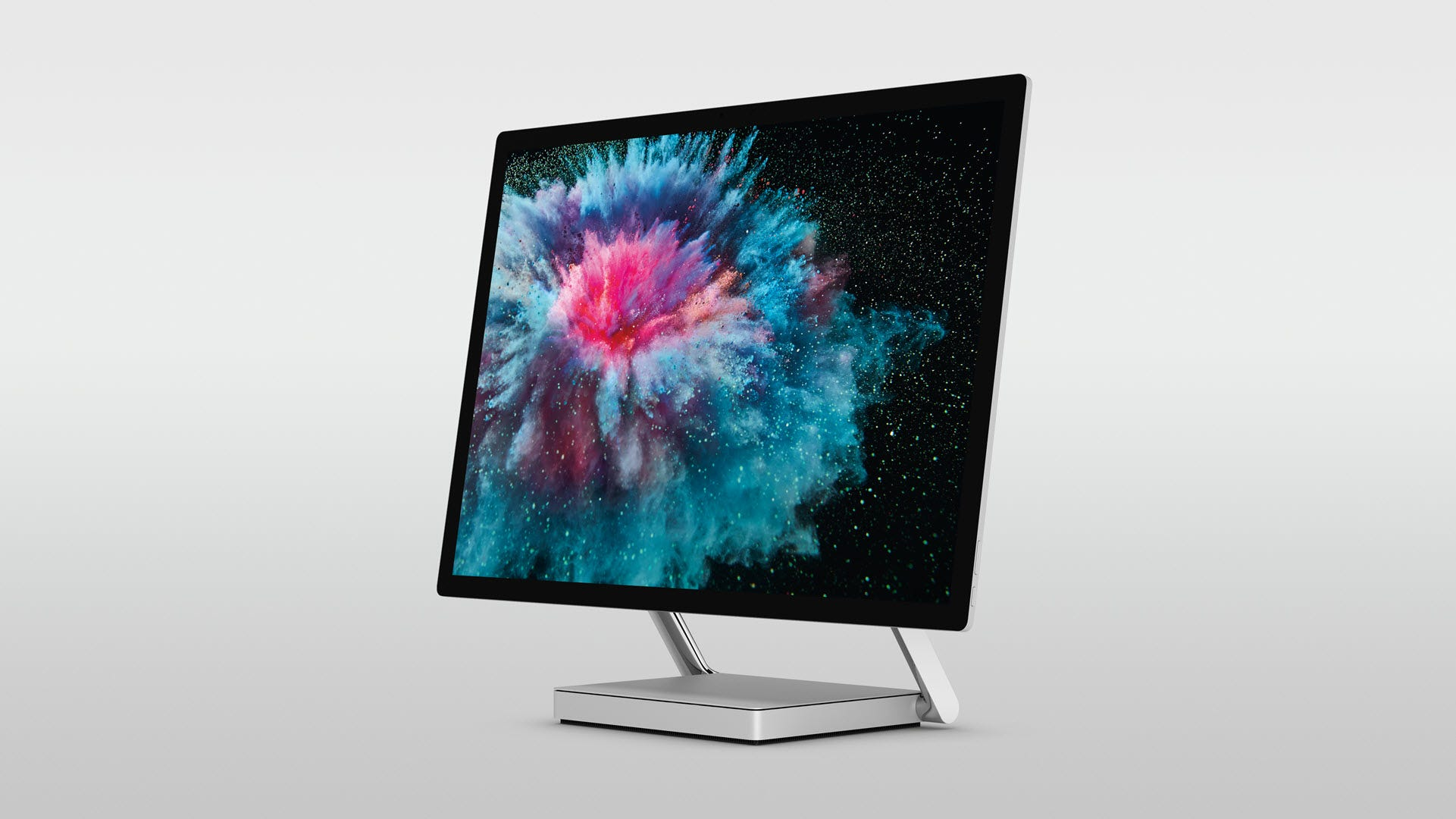 A Surface Studio 2 on a grey background