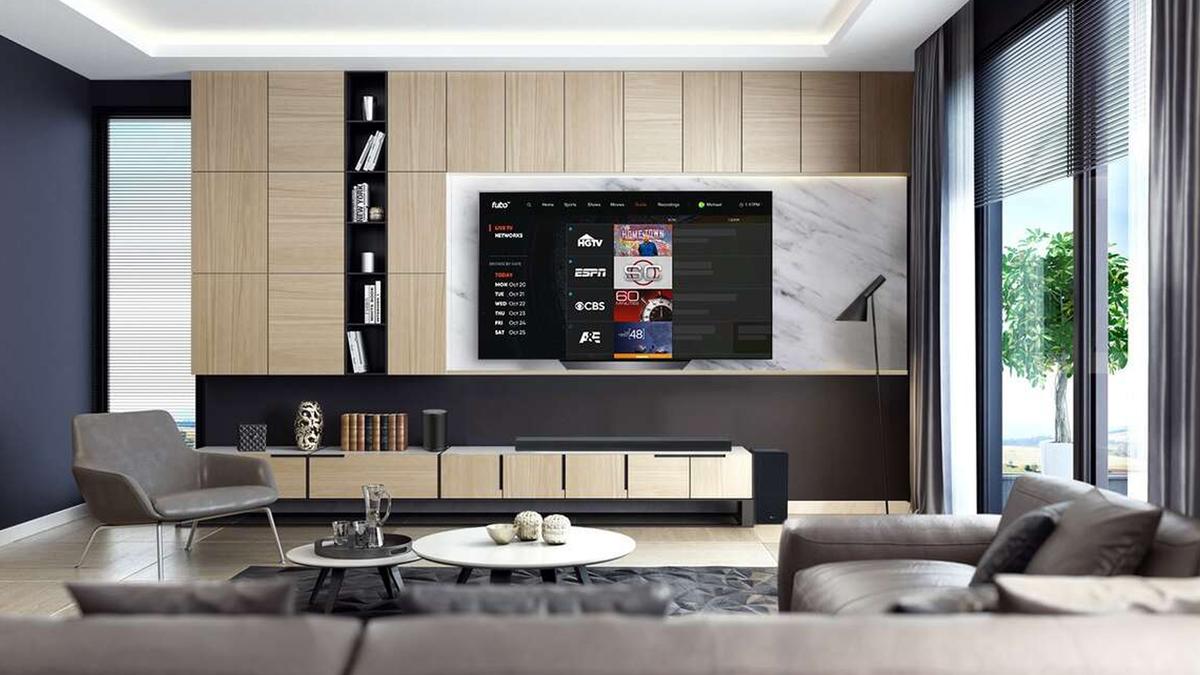 fuboTV on large TV in living room of bright modern home