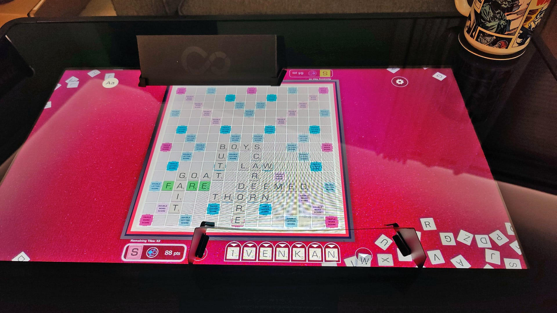 A game of 'Scrabble' with paper screens blocking the view of pieces