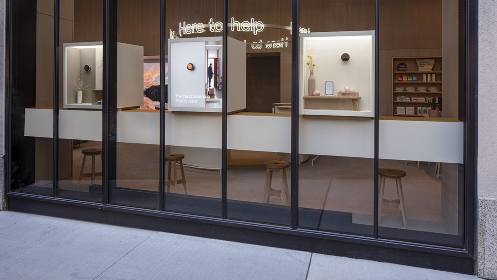 View of the store's exterior, with product display boxes in the window