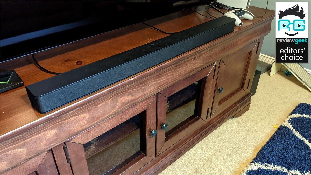The Vizio V-Series soundbar on a wooden entertainment center