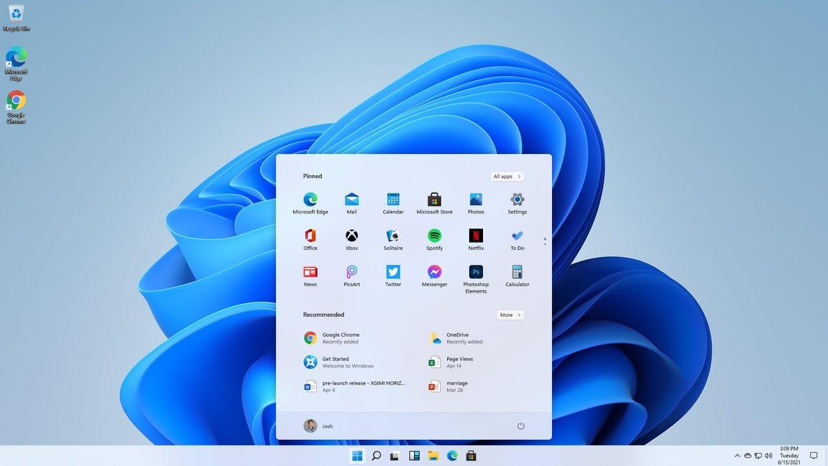 Microsoft Windows wallpaper with software utilities menu.
