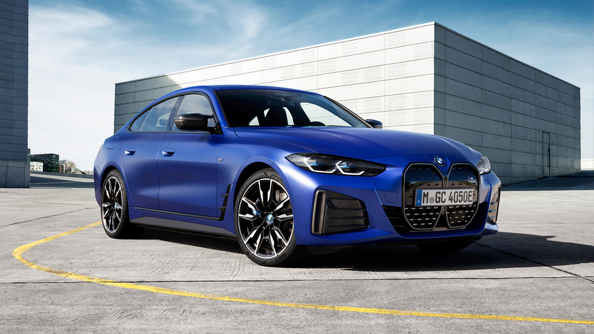 BMW i4 M5O in blue in an industrial setting
