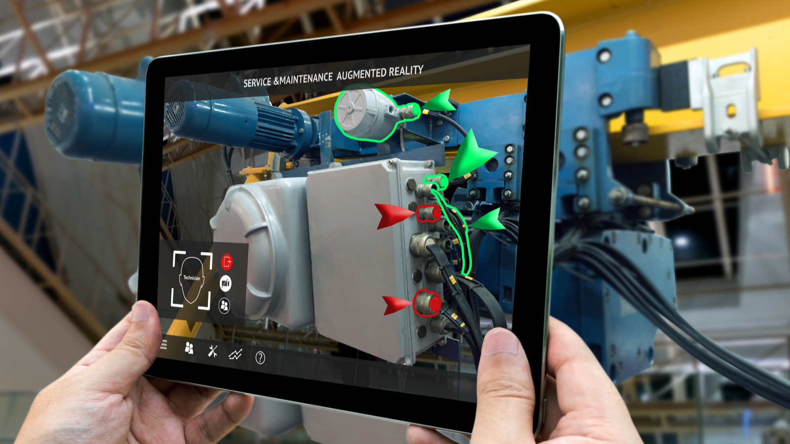 Hand holding tablet with augmented reality app open for service and maintenance app for technician for factory repair