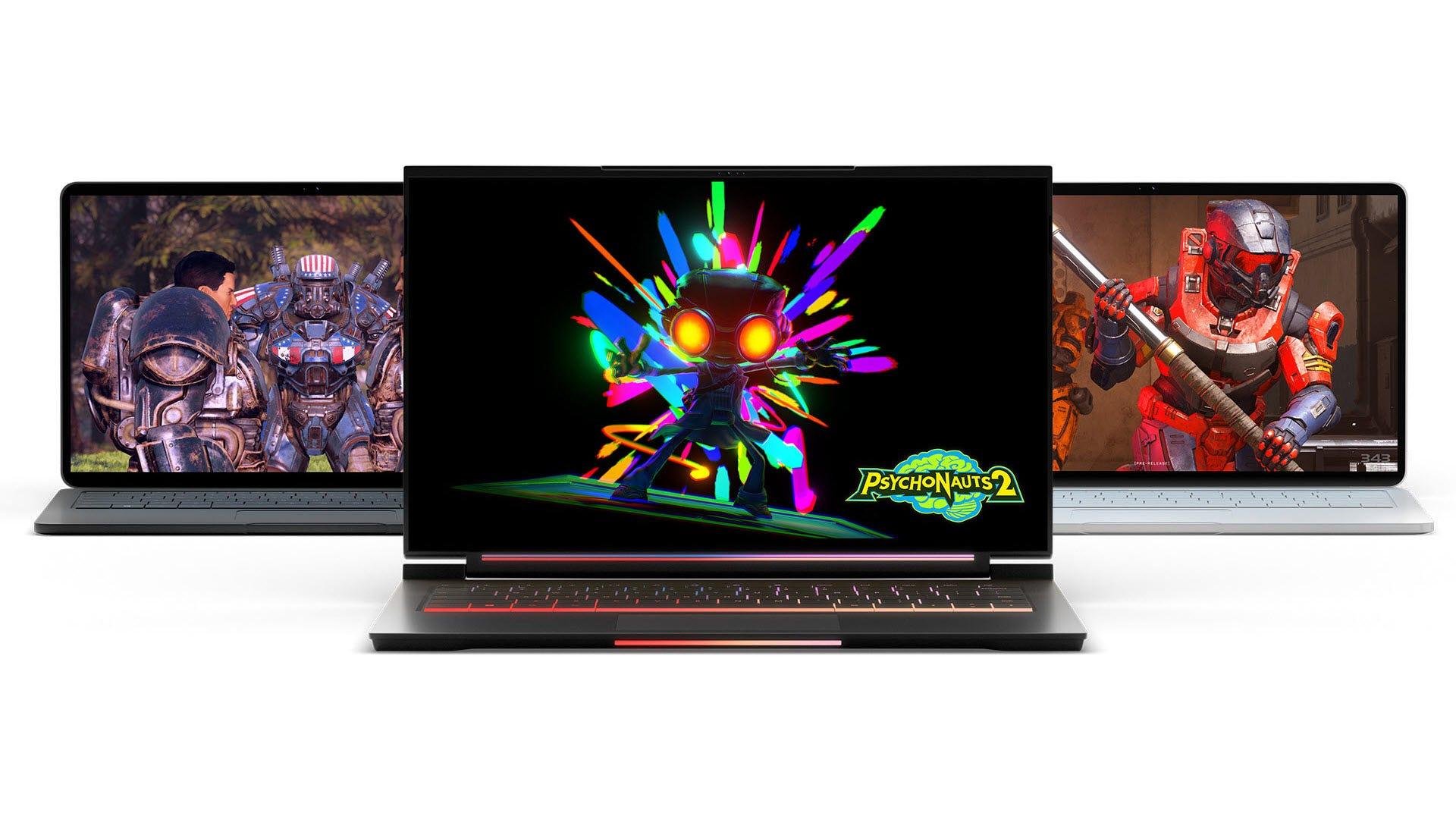 Three laptops playing PC games