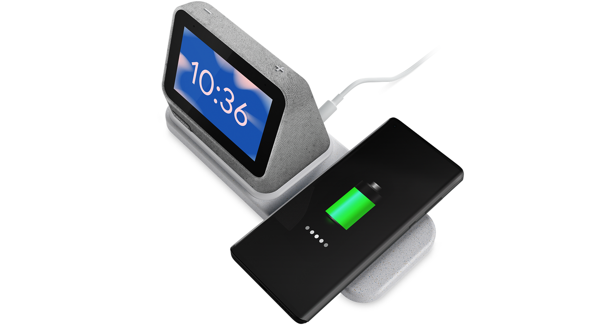 The Lenovo Smart Clock 2 wirelessly charging a phone.